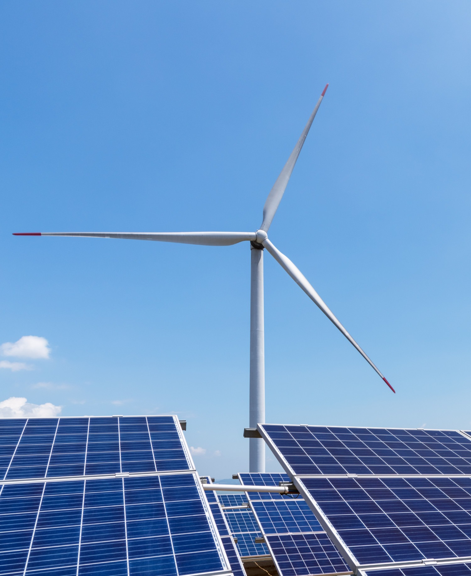 wind turbine over solar panels