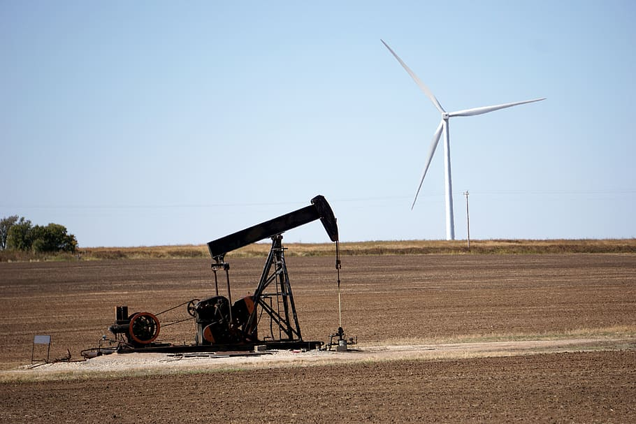 Oil rig and wind turbine tower in same scene